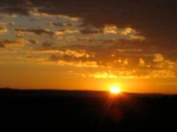 The Sun Rising in the Horizon